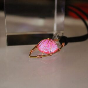 Glowing Eye Pendant Necklace Cradled in Copper Wire